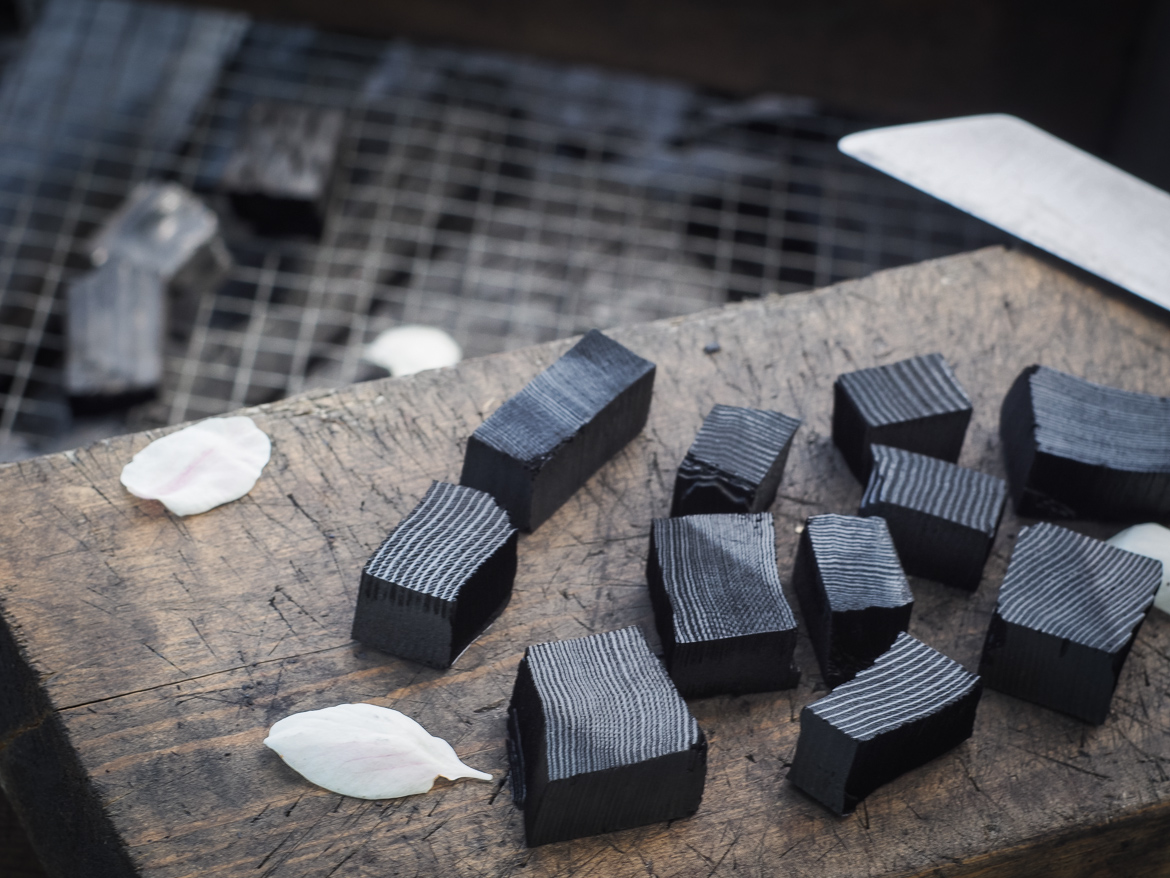 Sumi-kiri chopping softwood charcoal for swordsmithing