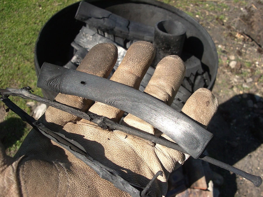 Making blacksmithing charcoal by hand.