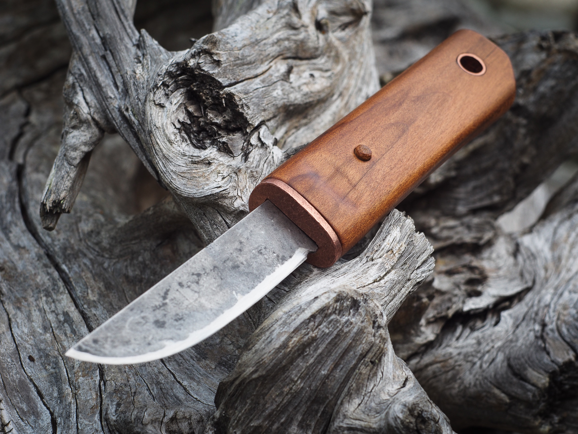 Island Blacksmith: Hand forged knives reclaimed from files and farm equipment.