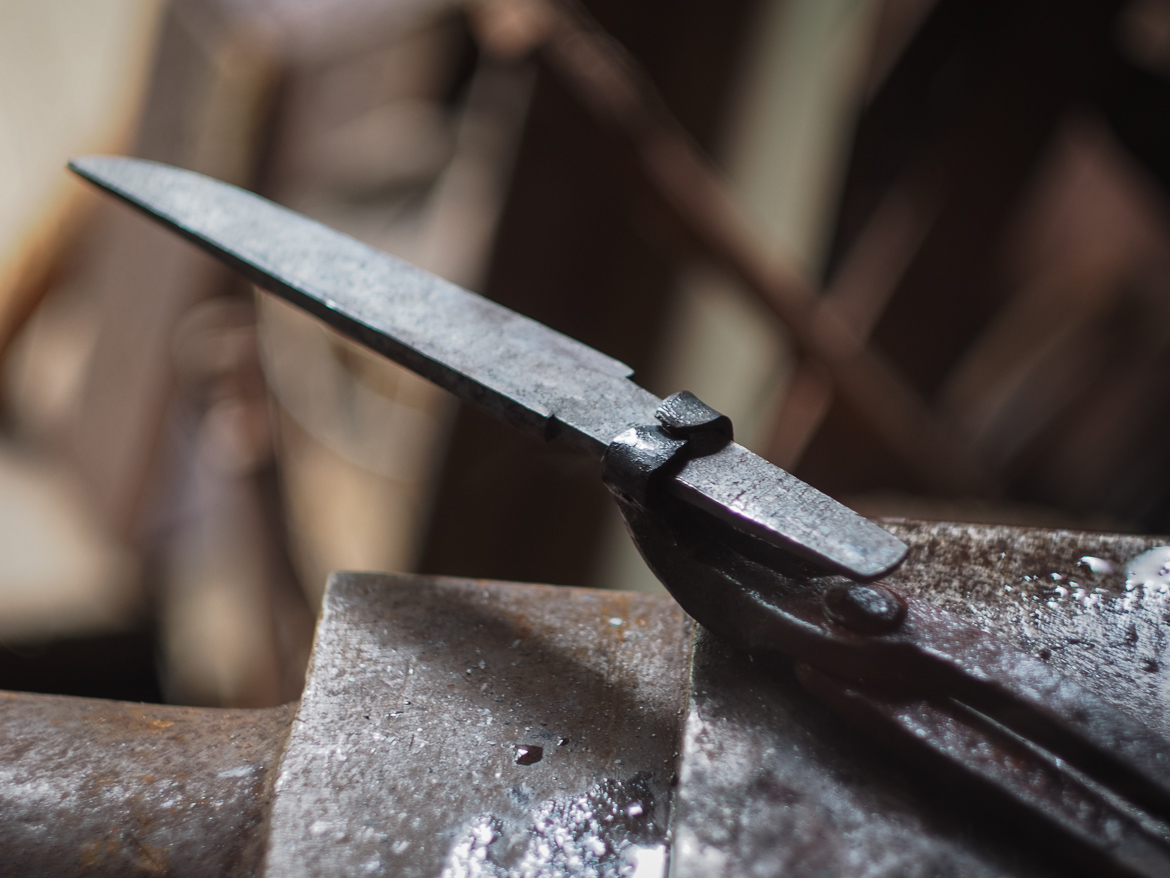 Island Blacksmith: Hand forged knives reclaimed from old farm equipment.